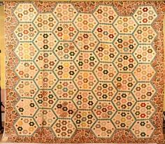 """PA floral et géométrique couette avec Calicot frontière. : Early 19th Century Pennsylvania Floral and Geometric Patchwork Quilt with Chintz Border. Old paper note attached """"Copper plate quilt made by Mrs. John James Rayburger of Philadelphia"""", with other provenance written on same note. 106"""" x 116"""""""
