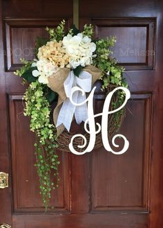 This lovely Monogram wreath is perfect for your front door!! Beautiful flowing greenery (artificial) is throughout the wreath    A scroll