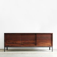 I love the way the wood grain was used on this credenza.  It almost looks like a sunset.