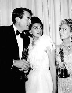 Gregory Peck, Sophia Loren and Joan Crawford at the Academy Awards, 1963.