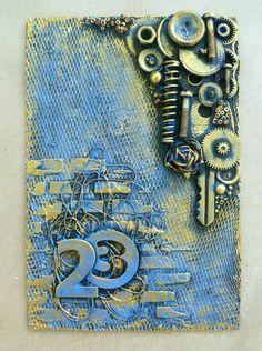 Предлагаю сделать открытку-магнит к предстоящему празднику 23 февраля. Я думаю, справиться сможет каждый! Для работы потребуется: - бумага для акварели - магнитный винил - жесткий фатин - универсальный клей - акриловый грунт - текстурная паста - трафарет - акриловые краски - разнообразная мелочь (пуговицы, шестеренки, ключи, нитки, бусины, бисер, пружинки и т.п.) Приступим. 1.