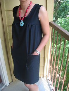 Non-form fitting black summer dress-- and it even has pockets! What is not to love about this?!? - Wonder if I can make something like this? Old t-shirts maybe?