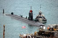 Los Angeles class submarine USS San Juan arrives for a port visit and prepares to be berthed next to submarine tender USS Emory S. Land