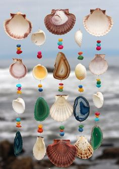 This beach house mobile is ideal for your coastal home or to remind you of memories of good times at the beach. The chimes hang from an awesome piece of driftwood collected from beaches in the Pacific Northwest. It features five beautiful geo agate slabs and multi-colored stone