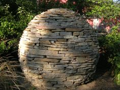 This dry-stacked stone sphere was built in the Secret Garden at Northwind Perennial Farm in Burlington, WI by Steve Coster and the Northwind Landscape Design team.