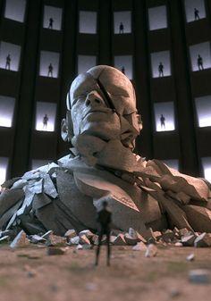 New Era - Adam Martinakis escultura peli cuadricula gente cabeza emerge tierra escala (POland)