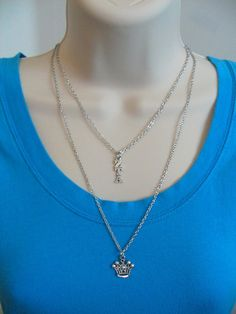 Stainless steel double chain sorority charm necklace features a sterling silver plated Greek letter lavaliere (1/4Wx 7/8L) and a small silver crown charm (3/4diameter). Officially Licensed Product.  Long chain is approximately 23 inches, shorter chain with Greek letters is 17 inches. Both are attached with a single lobster clasp. Chain and clasp are both base metal alloy. Perfect gift for sorority initiation, Bigs and Littles, new pledges, holidays and birthdays, or just becaus...