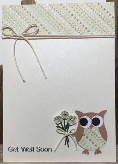 Lovely handmade Get Well Soon card featuring a very cute owl holding a bunch of flowers. The owls tummy is co-ordinated with the band of coloured cardstock at the top of the card and the flowers are made from the same cardstock. Ivory Pearlised card with light-brown Stampin UP Owl Punch Builder Owl. Glittered dotted patterned cardstock in Green, Browns and Orange is used at the top, on the owls tummy and for the tied bouquet. Cream waxed cotton runs around the top of the card. The bunch of…