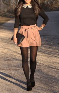 Pink bow high-waisted shorts, black sweater with a collared blouse under, opaque tights, and heels
