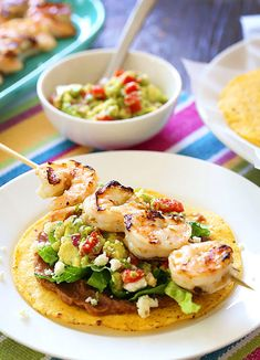 Shrimp Tacos Discover Grilled Shrimp Tostadas Grilled shrimp homemade guacamole fat free refried beans and lettuce on top of a crispy tostada. Super easy and quick youre going to love these! Seafood Dishes, Seafood Recipes, Mexican Food Recipes, Dinner Recipes, Cooking Recipes, Healthy Recipes, Delicious Recipes, Grilled Recipes, Skinny Recipes