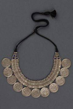 India | Silver necklace made with 11 Indian Silver Rupees, blue cloisonne enamel and cord | ca. 1st half 20th century