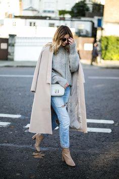 Emma Hill wears beige swing coat, grey fluffy sweater, light wash ripped Levis 501 boyfriend jeans, grey cross body bag, nude block heel ankle boots, chic neutral winter outfit