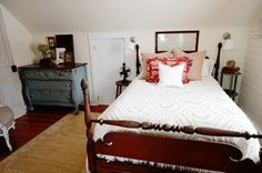 In the guest room she stenciled a border on an inexpensive jute rug. The dresser was also transformed by her handiwork.