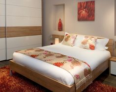 Bedroom Design, Modern Bedroom With Cool Modern Wardrobe Design With Wood Veneer Accent Also Modern Wooden Double Bed Frame Also Cushions With Peach Color And Floral Pattern Also Scarlet Fur Rug Color Also White Sheet: Design and Ideas of Wardrobes for Small Bedrooms