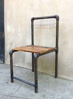 diy industrial pipe chair - needs boards on back. Use different straps to connect board to pipe.