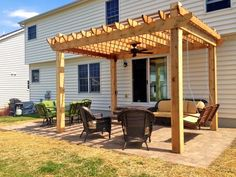Pergola with a ceiling fan and porch swing