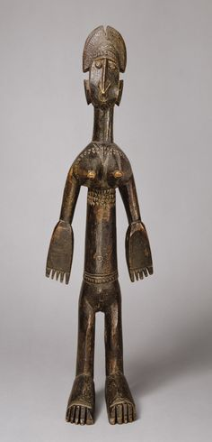 Female Figure, 19th–20th century Bamana peoples; Mali. Young unmarried Bamana men use nyeleni sculpture to represent the ideal marriageable woman they hope to find as a wife and partner. Social changes in the twentieth century have greatly impacted the role of initiation societies in Bamana culture.