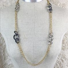 Long Necklace Brand new never worn long flowing necklace with silver interlocking loops and bronze interlocking loops with diamond stones in loops facing Jewelry Necklaces