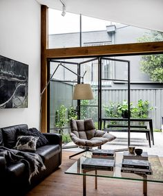 timber surrounds on the black window frames (on inside only) | via Handsome Sexy Man Rooms ~ Cityhaüs Design