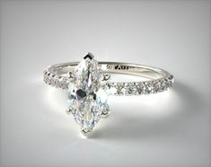 A vibrant pavé set diamond crown, featuring pavé accents on the prongs and gallery creates the perfect basket for the center diamond of your choice. The demure and feminine feel of this alluring ring is enhanced by the petite band accented with diamonds that extend 1/2 of the way down the shank. Diamond Crown, Marquise Diamond, Shank, Diamond Engagement Rings, Diamonds, White Gold, Vibrant, Basket, Feminine