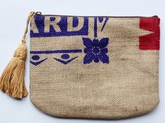 I'm seeing repurposed interfaced coffee sacks lined with Liberty floral and finished with a handmade tassel...