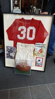 Framed U. of Maryland Football Uniform, ball and other memorabilia belonging to our clients Grandfather.  She had it made as a gift for her Dad. FastFrame of Annapolis