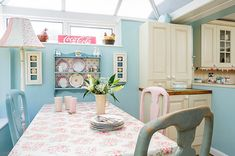 floral tablecloth and blue decorated dining space A Cottage Chic Cath Kidston Home