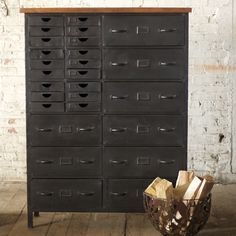 Five full feet of let's get busy! Nine standard size drawers with handles, another 18 smaller flat file drawers with finger pull openings. Cute little library plates for identifying contents. Wood top...