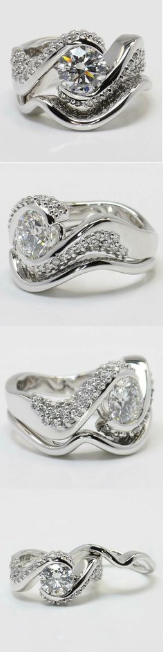 Twisted Diamond Engagement Ring and Matching Band in White Gold! Round 1.61 Ctw. Color: F Clarity: SI1 Cut: Excellent Diamond/Gem Cost: $14,736 Side Carat: 0.93 Side Color: G-H Side Clarity: VS2 Width: Side Cut   Ideal Setting Cost: $4,100 Total Cost: $18,836 www.brilliance.com