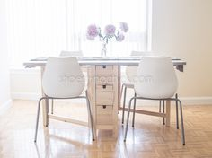 When it comes to the apartment dining table, saving space is important. We found an affordable space saving table which we then updated a bit. Thanks Ikea!