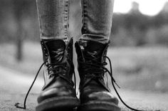 black-boots-feet-grey-jeans-standing-
