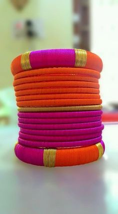 Pink and Orange Silk Thread Bangles Note: This is a made-to-order product and will be shipped within 7 to 10 days from the order date. Silk Thread Bangles Design, Silk Bangles, Silk Thread Earrings, Bridal Bangles, Thread Jewellery, Fabric Jewelry, Bridal Jewellery, Tassel Earrings, Silver Bracelets