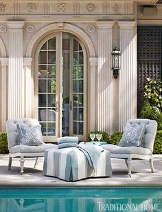 Tufted chairs and an ottoman are covered in all-weather Perennials fabrics.