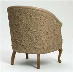Leather carved tub chair 'Bloom' design by Helen Ann Murray