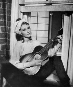 Audrey Hepburn singing Moon River in breakfast at tiffanys.... This is my fave part of the movie...