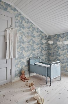 Dreaming of a simple, sophisticated nursery for your little one? Our wallpaper Raphaël in a soft blue shade creates the perfect backdrop to… Tree Leaf Wallpaper, Large Floral Wallpaper, Forest Wallpaper, Wood Wallpaper, Kids Wallpaper, Pattern Wallpaper, Flower Wallpaper, Wallpaper For Nursery, Wallpaper Ceiling