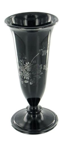 Offered here is an Vintage Black Amethyst Footed Fluted Bud Vase with silver overlay patterns, Sterling Trim around the foot of the base, and a pretty floral bouquet in sterling on the front facade. Description from ebay.co.uk. I searched for this on bing.com/images