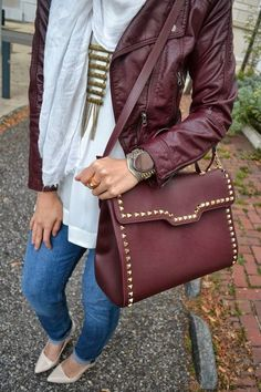 Maroon bag with gold studs. Matching jacket.