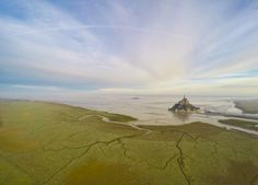 Early one morning as the water slowly turned Mont Saint Michel in Normandy, France, into an island once more, Jeremie Eloy was on hand to record the moment with his drone camera.