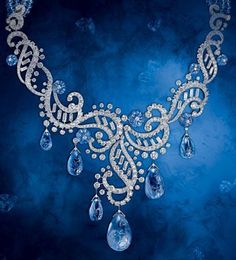 Cartier's high jewelry sapphire series necklace. It is made by platinum, diamonds and sapphires with much attention. There are seven oval-shaped incised sapphires dropping below diamonds and platinum is curved into hollow patterns. They inlay with each other and the oblong diamonds in the hollow area just like shiny spray