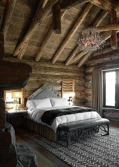 The chandalier makes it for me..I would probably paint the wood on the walls to brighten it up a bit but lovely natural space.