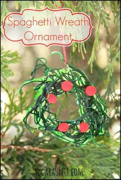 This Kid-made ornament made from spaghetti is great fro fine motor, sensory, and gross motor skill! By Sugar Aunts
