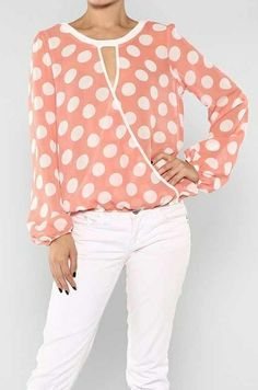 Fun and fashionable polka dot blouse with keyhole front.