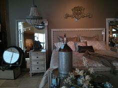 Love a chandelier in the bedroom... and here they have one over each nightstand.  Love it!