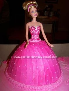 Homemade Barbie Birthday Cake: I made this Barbie Birthday Cake using the Wilton wonder mold. I used 1 3/4 box cake mixes in the mold and 2 cake mixes for the base layer cake. I iced