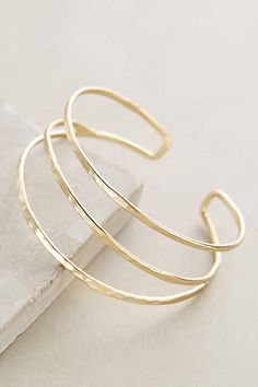 Anthropologie EU Strands Cuff. Delicate, minimal curves add a refined accent to ensembles, whether dressed up or laid-back. A most elegant, versatile addition to jewellery boxes.