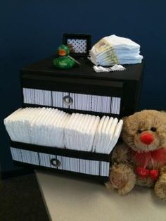 Case 1/2 of new born Pampers wrapped like a dresser for a baby shower ;)  I used card stock and a shoe box for the drawers