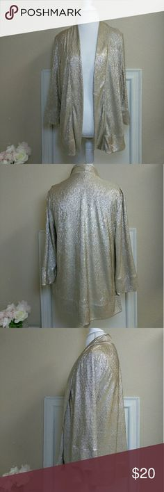 Shiny gold cardigan Dress up you outfit with this shimmery cardigan. It is thin and light weight. It would go great with jeans or a pencil skirt... A anything really. Sweaters Cardigans