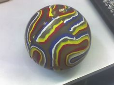 Super Ball...Small, hard rubber ball that bounced crazy high and ricocheted off everything it hit! Loved it.  ;-)