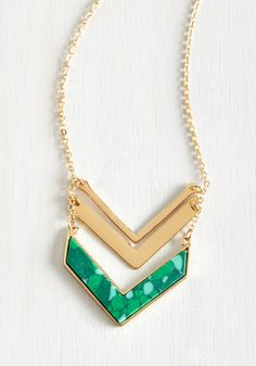 Terrace at my Heartstrings Necklace in Green. With the sunset painting the sky, a glass of local wine in hand, and this golden necklace topping off your outfit, your heart feels whole. #gold #modcloth